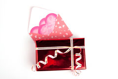 Gift for Valentine's day. Pink packet  and red box with gift for Valentine's day Royalty Free Stock Photos