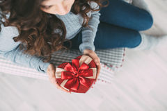Gift for Valentine's Day. A girl holding a gift box heart. Top view photos Stock Photo