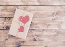 Gift for Valentine's Day with red hearts Stock Photos