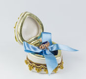 Gift for Valentine`s Day. Valentine`s sapphire ring box tied with blue ribbon Royalty Free Stock Photography