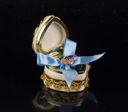 Gift for Valentine`s Day. Valentine`s sapphire ring box tied with blue ribbon Royalty Free Stock Photo