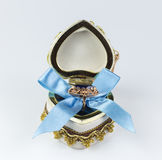 Gift for Valentine`s Day. Valentine`s sapphire ring box tied with blue ribbon Stock Images