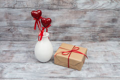 Gift for Valentines Day with hearts and vase on stick Royalty Free Stock Image