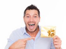 Gift voucher man. Present gift holding man looking camera Stock Image