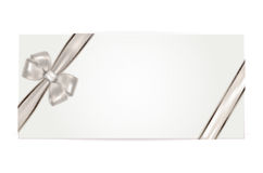 Gift voucher with silver bow Royalty Free Stock Images