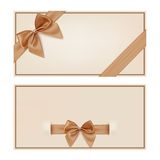 Gift voucher template with golden ribbon and a bow Royalty Free Stock Photography