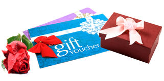 Gift vouchers and gift box. With rose flower over white background stock photos
