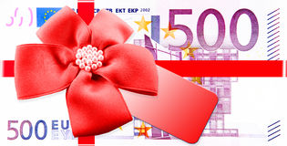 Gift Vouchers. Red ribbon and label to banknotes Royalty Free Stock Photography