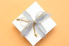 Gift in a white box with a lil. Ac tape Royalty Free Stock Photos