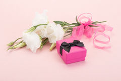 Gift and white flowers Stock Photos