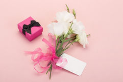 Gift and white flowers Stock Image