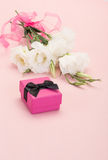 Gift and white flowers Stock Photography