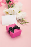 Gift and white flowers Royalty Free Stock Image