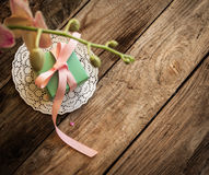 A gift on a white napkin. Andorchidea on the wooden background Royalty Free Stock Image