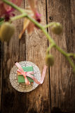 A gift on a white napkin. And orchidea on the wooden background Royalty Free Stock Photos