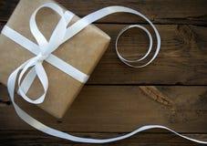 Gift With White Ribbon Royalty Free Stock Photos