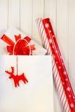 Gift with white shopping bag Stock Photos