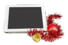 Gift white tablet with Christmas ball, box and red chain Stock Photo