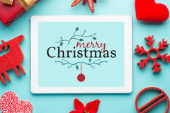Gift white tablet with Christmas ball, box and red chain Stock Photography