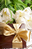 Gift and white tulips Royalty Free Stock Photography