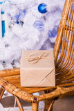 Gift on a wicker chair Stock Photography