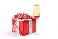Gift and Wine. Wrapped gift and a glass of white wine Stock Photos