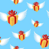 Gift with wings pattern. Flying gift box with red bow and ribbon. On blue sky. present background Royalty Free Stock Images