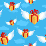 Gift with wings pattern. Flying gift box with red bow and ribbon. On blue sky. present background Stock Photo