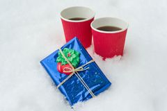Gift, winter background - snow, two cups coffee. Gift, winter background - snow, two cups of coffee Royalty Free Stock Image