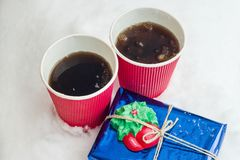 Gift, winter background - snow, two cups coffee. Gift, winter background - snow, two cups of coffee Stock Image