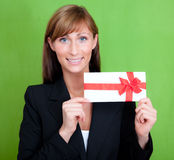 Gift woman. Business woman hodling gift bonus greeting card on green background Stock Photo