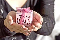 A gift in woman hand. Close up of a gift in woman hand Royalty Free Stock Photo