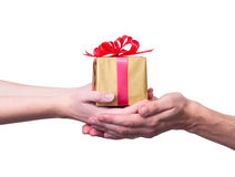 Gift. Woman & man hand. Holding a gift. isolatrd on white background Stock Image