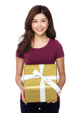 Gift woman smiling and showing present Stock Photo