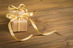 Gift on wood Stock Images