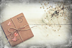 A gift on wooden background with hearts Royalty Free Stock Image