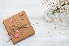 A gift on wooden background with hearts Royalty Free Stock Photography