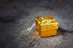 Gift on a wooden surface Royalty Free Stock Photo
