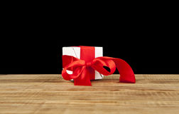 Gift. A gift on a wooden table Stock Photos