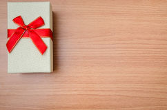 Gift on wooden table Royalty Free Stock Photo