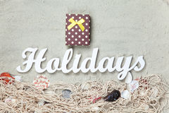 Gift and word Holidays with net and shells Stock Images
