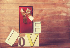 Gift and word Love Royalty Free Stock Images