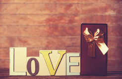 Gift and word Love Stock Photography