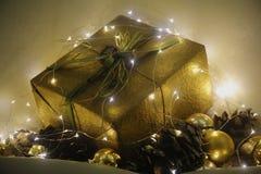 Gift wrap. Christmas gold whit decoration Stock Photo