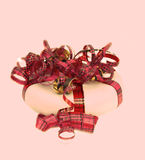 Gift wrap. A gift-wrap, on pink blurred background Royalty Free Stock Photography