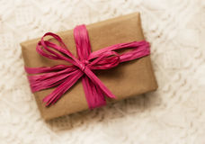 Gift wrap with pink bow Stock Photo