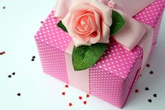 Gift wraped with pink white polka dot paper. With rose and ribbon Royalty Free Stock Photography