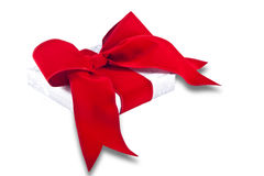 Gift Wrapped. A gift wrapped present with red ribbon and bow set against a white background Royalty Free Stock Photo