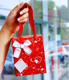 A Gift Wrapped Bag Being Held Up Royalty Free Stock Image