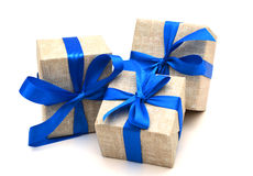 Gift wrapped blue ribbon Stock Photos